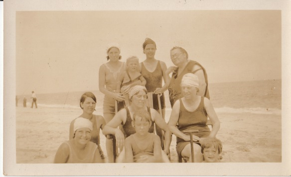 """Seaside photo, 1932. As labeled by Dorothy Veronica """"Dot"""" (TRAUTMAN) SCHAFER, my dad's sister, my Aunt Dot. Top, left to right: Marion Rita TRAUTMAN (the oldest of my dad's siblings), James Joseph TRAUTMAN (my dad, age 3), """"a friend,"""" Marion Ann (RENFRO) ANTON. Middle, left to right: """"A friend,"""" Unknown, Dot's Godmother. Front, left to right: Dorothy Veronica TRAUTMAN, """"a friend,"""" """"a friend."""""""