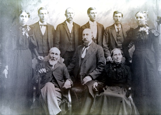 "Photo of Mum's seven children, husband George Kuhn, and Mum (Sarah). From left to right standing: Minnie, Ord, Allen, Emery, Winfield, Bithy. Sitting: George ""Pap"" Kuhn, Harve, and Sarah ""Mum"" (Johnson) Kuhn. Circa 1894-1896. I do not know who owns the original of this photo. Many family members have a print copy, including me. Copyright Notice: You do not have permission to download or copy this image without obtaining it from me. Thank you."